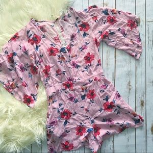 Adorable pink floral romper with pockets